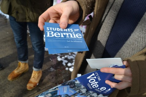 Volunteers hand out Bernie Sanders stickers at the primary in Keene, New Hampshire on Feb. 9, 2016.