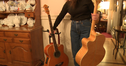 Mrs. Lacharite demonstrates how the empty guitar stand was discovered.