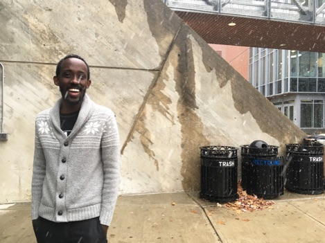 Edwin Murenzi expresses his hatred for the snow with a smile on his face.