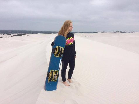 Sand boarding on the dunes outside of the city.