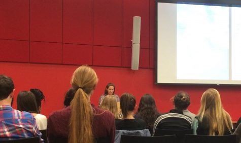 Pamela Olson speaks to a room full of students, faculty and community members. (Wei Cai/Amherst Wire)