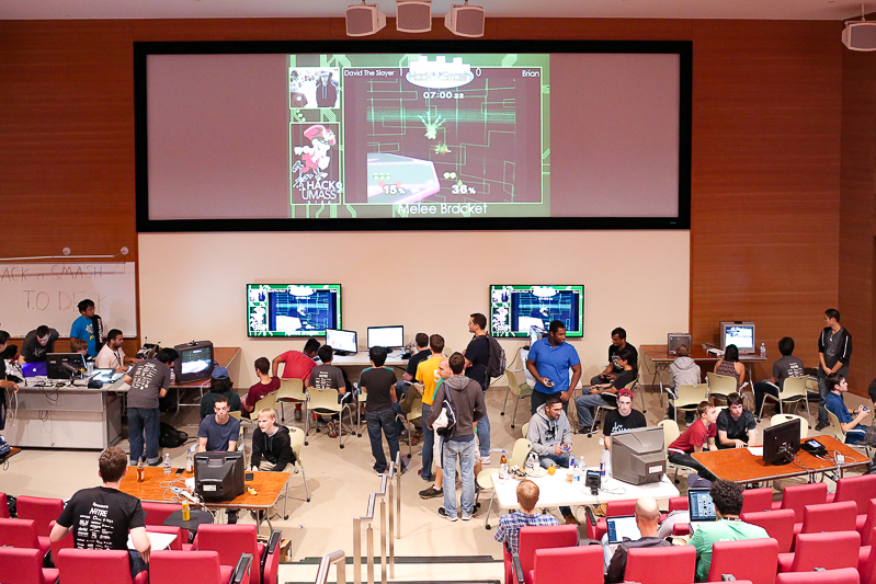 Students play games and hang out in the main lecture hall in the ILC Saturday night.