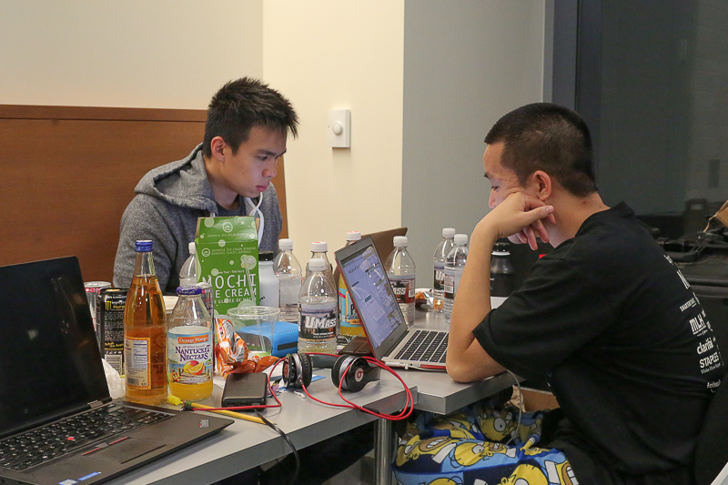 Khyteang Lim (left) and Son Nguyen work on a messaging app that can turn text from up to 20 languages into spoken word at the fourth annual HackUMass on Oct. 8, 2016.