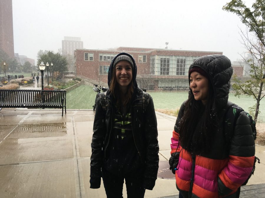 Juniors Alyssa Thompson and Kahani Lee amidst the snowfall on the UMass campus.
