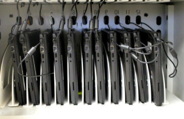 HP laptops sit in a charging station at Springfield's High School of Commerce.