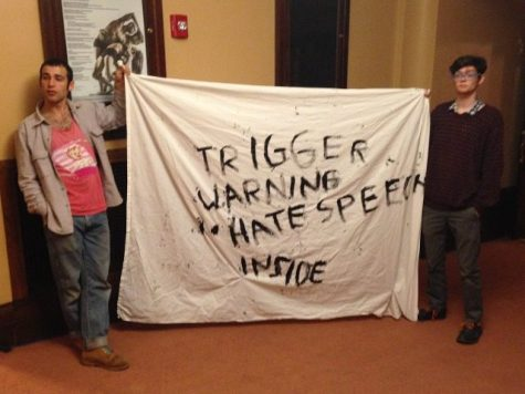 "(Mike Ma/Breitbart.com) UMass students protesting ""The Triggering: Has Political Correctness Gone Too Far?"" event with a bedsheet saying ""TRIGGER WARNING HATE SPEECH INSIDE."" The College Republicans Club of UMass event featured a discussion with Milo Yiannopoulos, Dr. Christina Hoff Sommers and Steven Crowder. Protesters accused the panel of hate speech and demanded they leave campus."