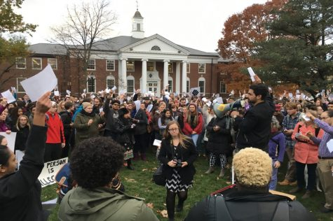 "Protesters gather at the Goodell Lawn on Wednesday, Nov. 16, 2016 during a walkout to turn UMass into a ""sanctuary campus."" (Joshua Murray/Amherst Wire)"