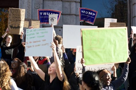 Anti-Trump protesters attempt to block the presence of Trump supporters across from a stop on their march through downtown Springfield. (Morgan Hughes/Amherst Wire)