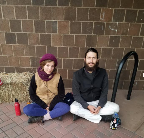 Alice Grendon and Dunan Herman-Parks mediate outside the polls.