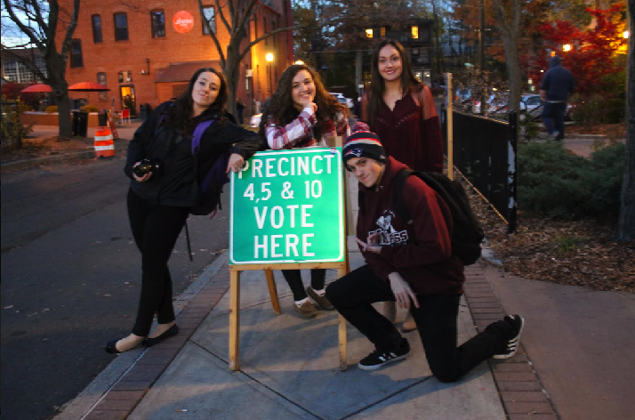 UMass journalism students Elissa Borden, Kathryn Fallah, John Coakley and Alexandra Pigeon (from left to right) outside the Bangs Community Center in Amherst.