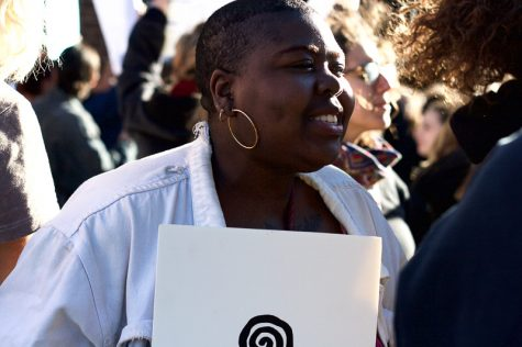 "Ebun Nazon-Power, 20, a student at Hampshire College, joins in chanting ""not my president"" at the protest in Springfield on Sunday, Nov. 13, 2016. (Morgan Hughes/Amherst Wire)"