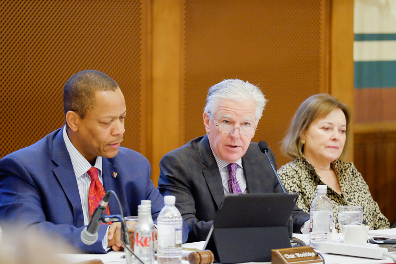(FILE PHOTO) Former UMass Vice President Victor Woolridge (left) and current President Marty Meehan (center) at a UMass Board of Trustees meeting on Dec. 9, 2016. (Joshua Murray/Amherst Wire)