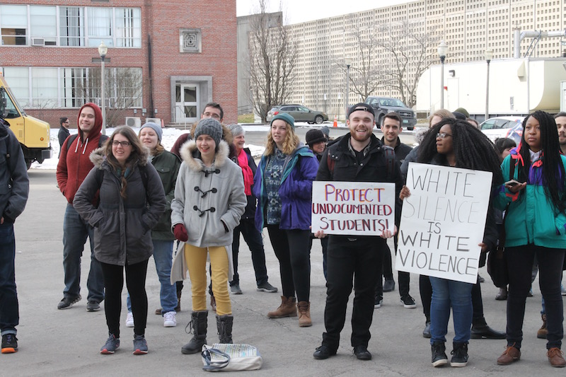 Protesters chant in front of the Student Union for a sanctuary campus on Feb. 3, 2017. (Julie Shamgochian/Amherst Wire)