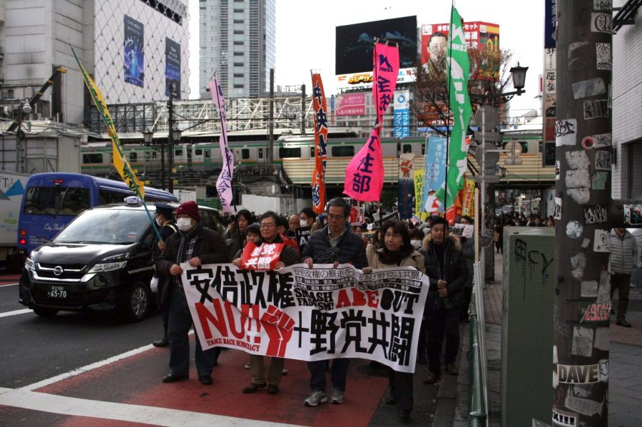 People lined the streets of Shibuya to protest their Prime Minister.