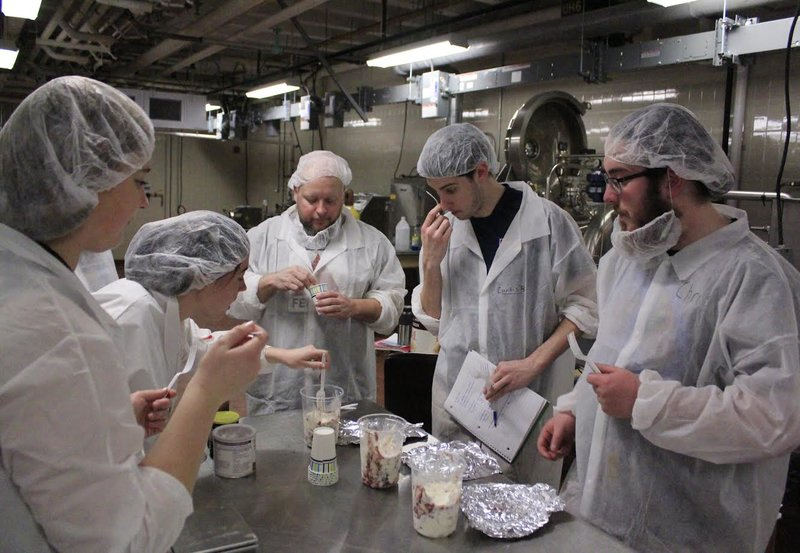 Jenna Woodward, Gretchen Mueller, Michael Barry, Curtis Barnes and Chris Von Achen (left to right) test ice cream flavors for the competition. (Matthew Hachisu/Amherst Wire)