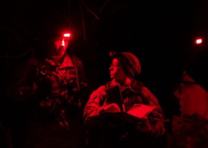 Second platoon ms3's prep in the dark for Saturday's exercise. (Jon Decker/Amherst Wire)
