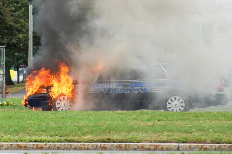 A+University+of+Massachusetts+police+vehicle+was+destroyed+Monday+morning+at+Haigis+Mall+after+its+engine+suddenly+caught+fire.+%28Laurie+Sexton%2FAmherst+Wire%29