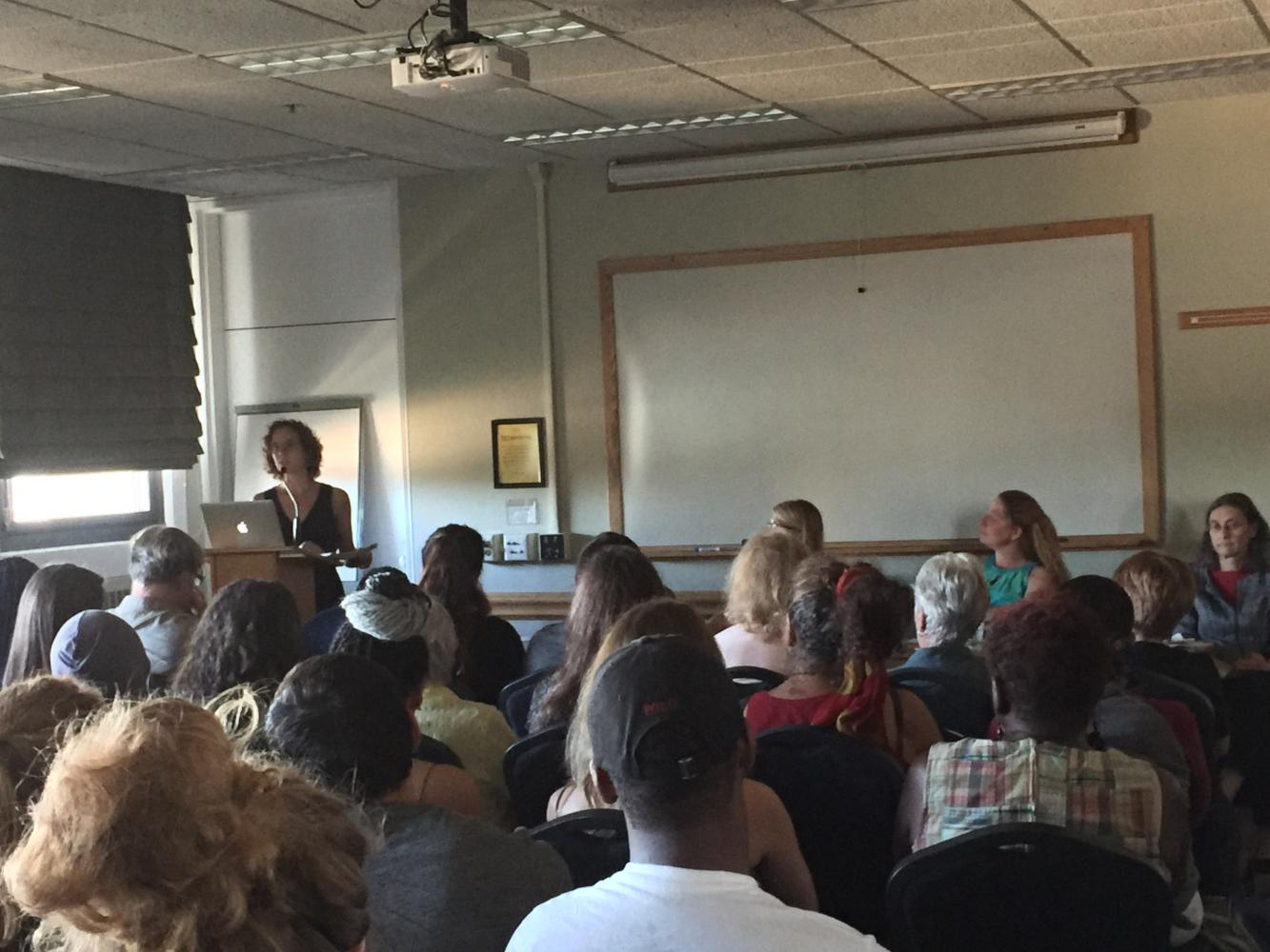 Panelist Kim Gilhuly addresses a room full of public health students and faculty in the Campus Center.