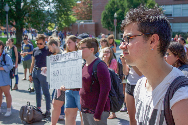 Nate Taskin (Right) listens to speakers at the Solidarity in Response to Charlottesville and DACA Rally outside the Campus Union.