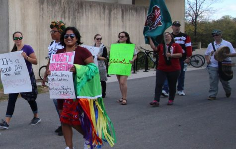 Community members march to celebrate Indigenous Peoples' Day