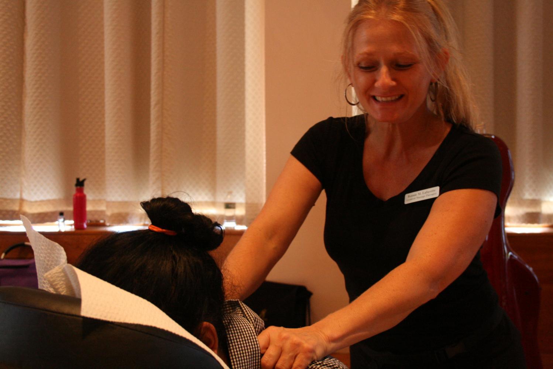 Massage therapist Bonnie M. Lafayette massaging UMass grad student Costin Thampikutty (Brian Choquet/Amherst Wire)