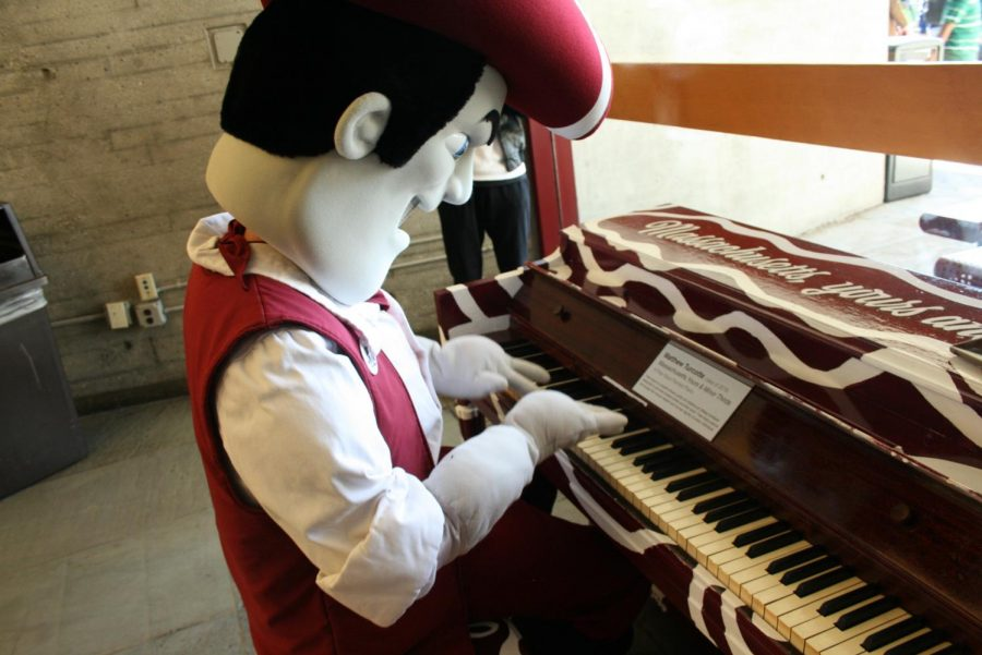 Sam the Minuteman attempts to play piano in the Campus Center on Thursday, Oct. 19, 2017. (Brian Choquet/ Amherst Wire)