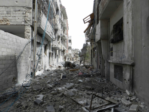 Destruction in Homs, Syria (Bo Yaser/ Wikimedia Commons).