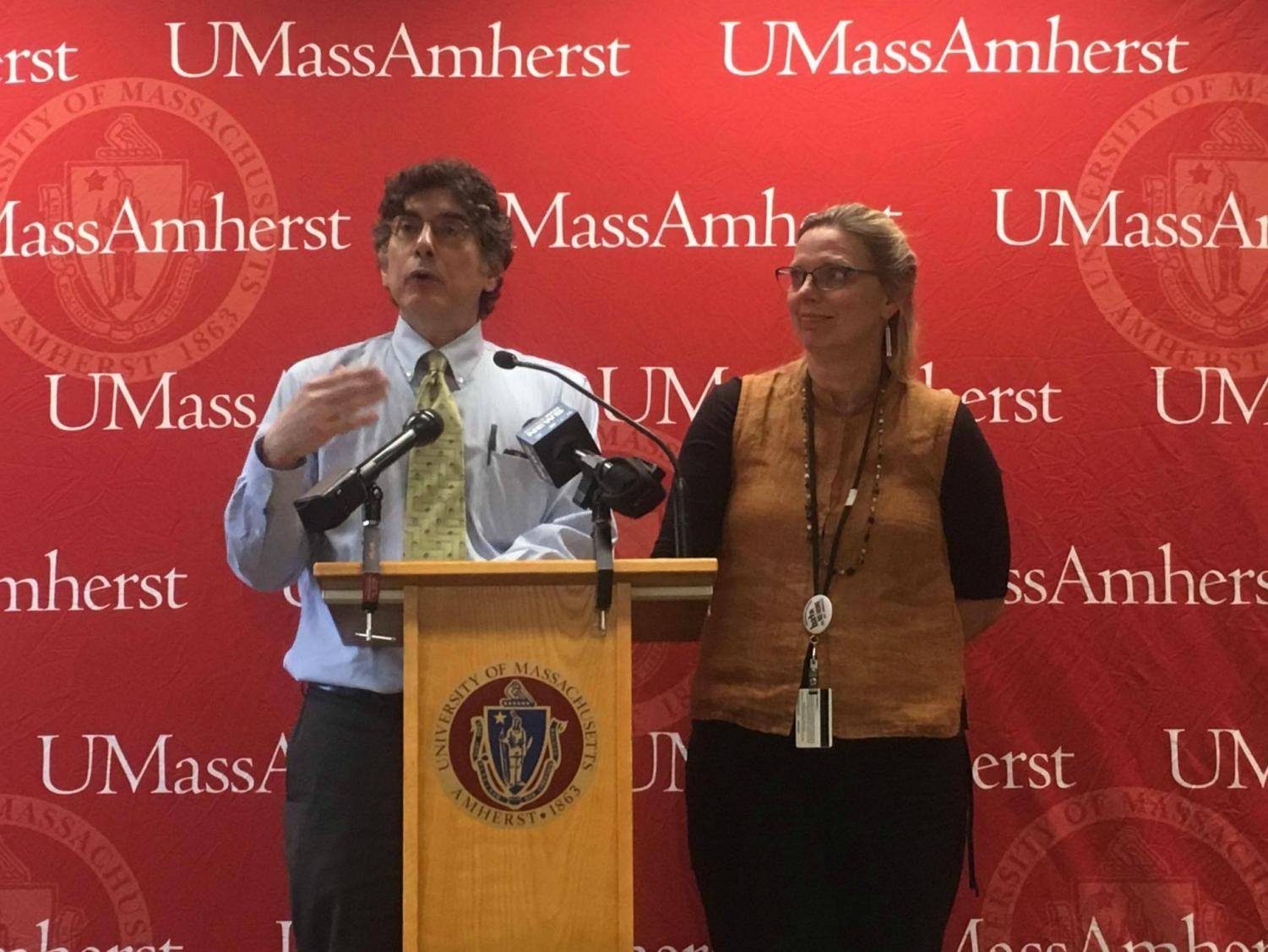 University Health Services Executive Director Dr. George Corey (left) and Public Health Nurse Ann Becker (right) address a crowd at a press conference in the Campus Center on Tuesday. (Cameron Merritt/Amherst Wire)