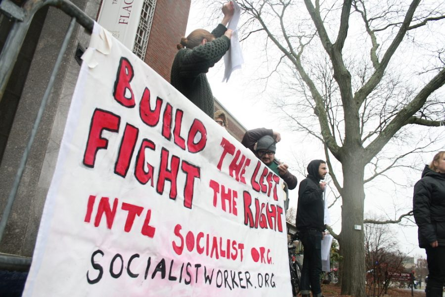 The International Socialist Organization hosted a rally against the proposed GOP Federal Tax Plan outside the University of Massachusetts Amherst Student Union, Dec. 5. (Brian Choquet/ Amherst Wire)
