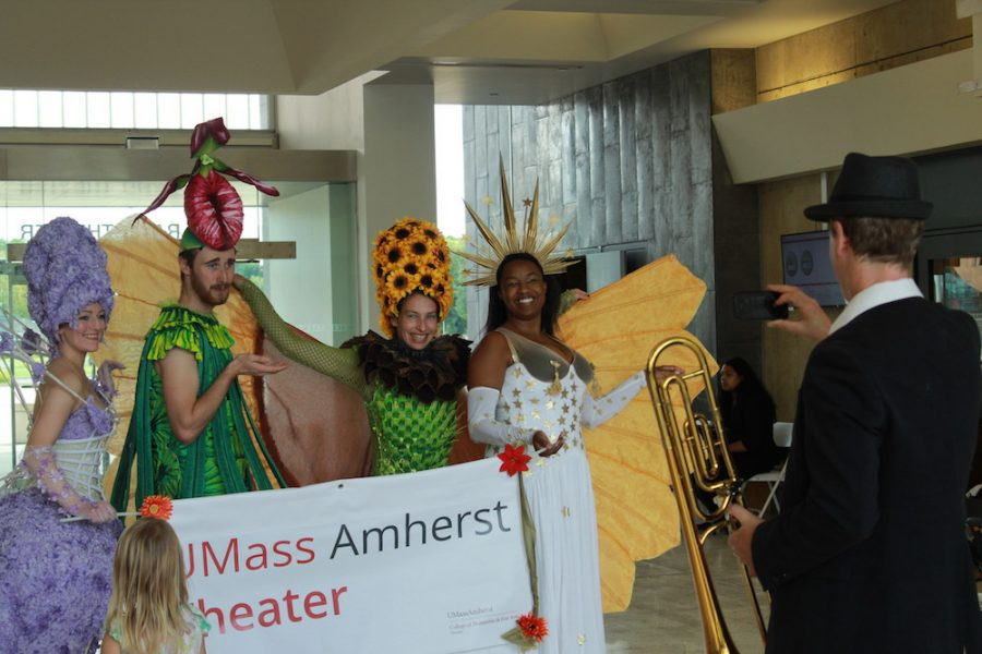 Performers clad in elaborate costumes, designed by UMass Theatres Christina Beam (far left), pose for a picture in the UMass Fine Arts Center lobby on Sat., Sept. 22, minutes before the start of the 4 p.m. parade. (Maria Manning/ Amherst Wire)