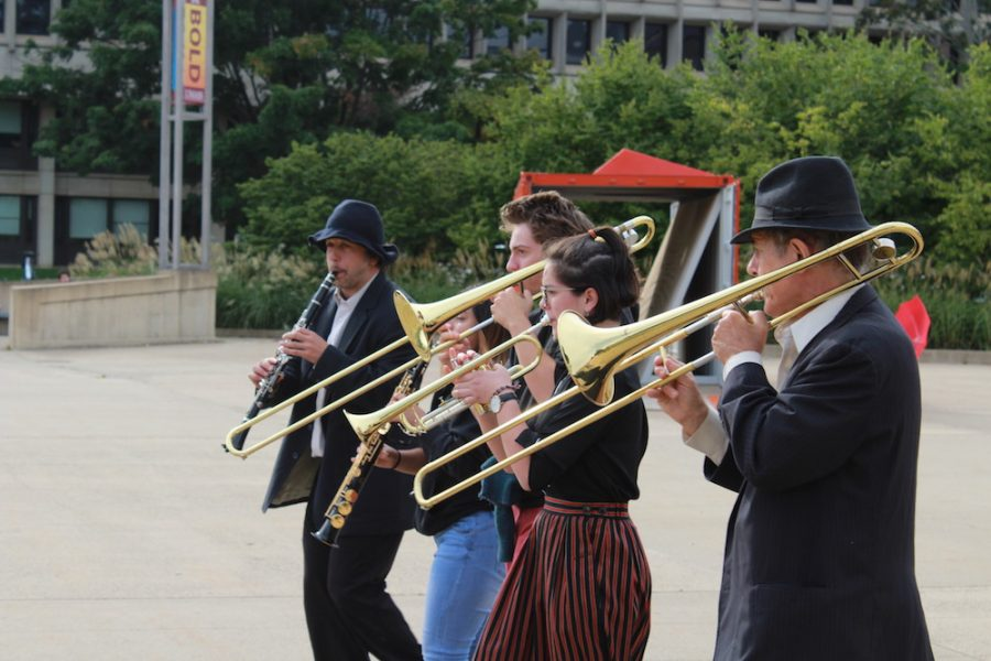 Musicians play lively tunes and lead the procession from the UMass Fine Arts Center down Haigis Mall. Maria Manning/ Amherst Wire)