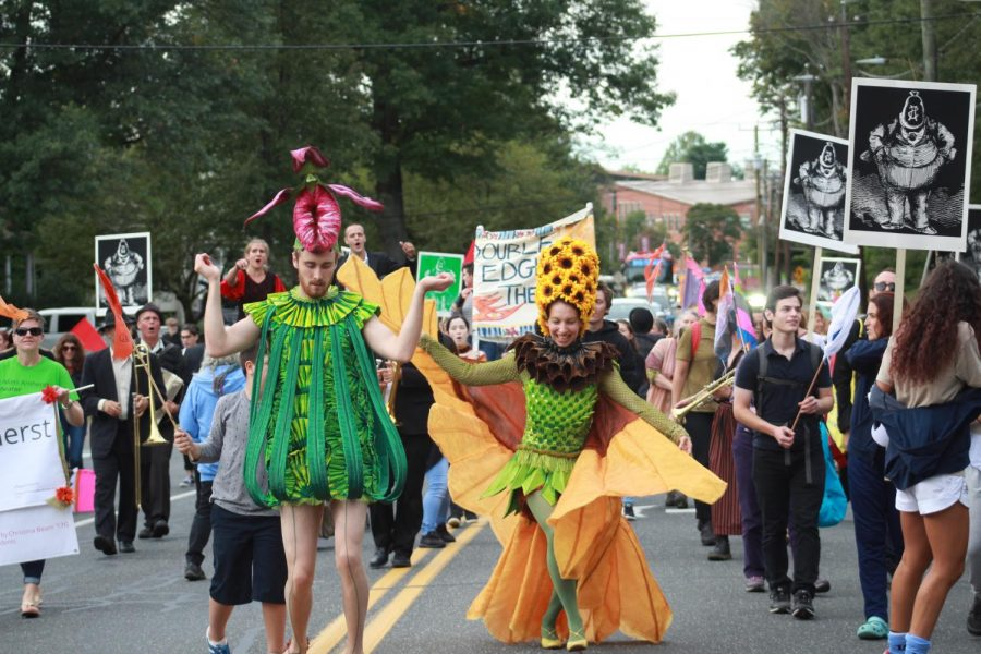 Performers, musicians and parade-goers create a colorful spectacle as they dance and sing along North Pleasant Street. (Maria Manning/ Amherst Wire)