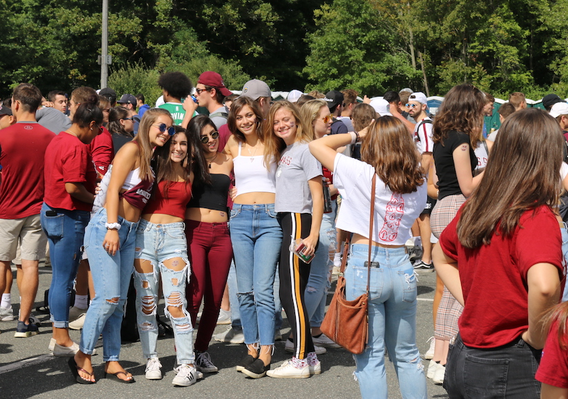 UMass students pose for a picture at the start of the tailgate in Lot 11. (Justin Risley/ Amherst Wire)