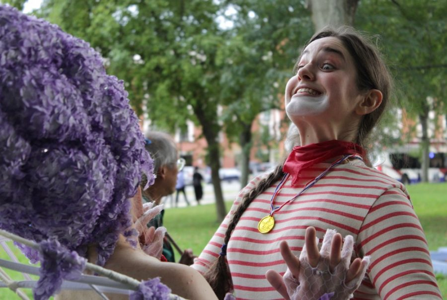 As the festivities wind down just before 5 p.m., TheatreTruck performer Linda Tardif goofs around with fellow performer, Christina Beam. (Brian Choquet/ Amherst Wire)