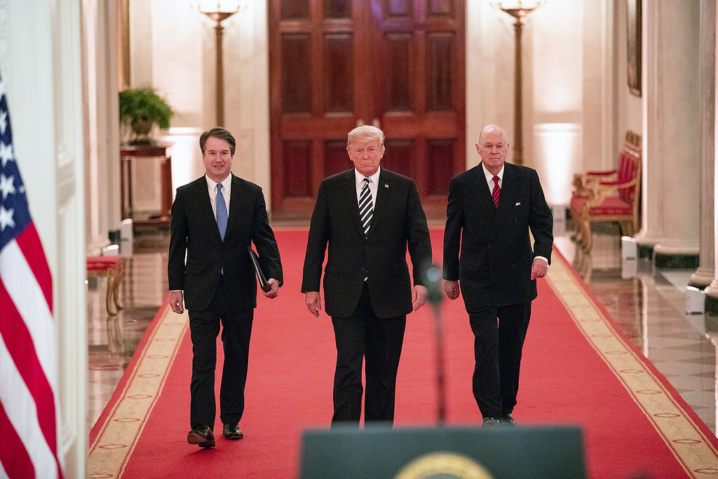 President Donald J. Trump, Judge Brett M. Kavanaugh and Anthony M. Kennedy, retired Associate Justice of the Supreme Court of the United States, walk together Monday, Oct. 8, 2018, to the East Room of the White House in Washington, D.C. (Official White House Photo by Joyce N. Boghosian)