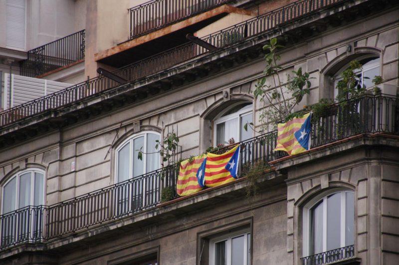 Catalonian flags hang on a balcony