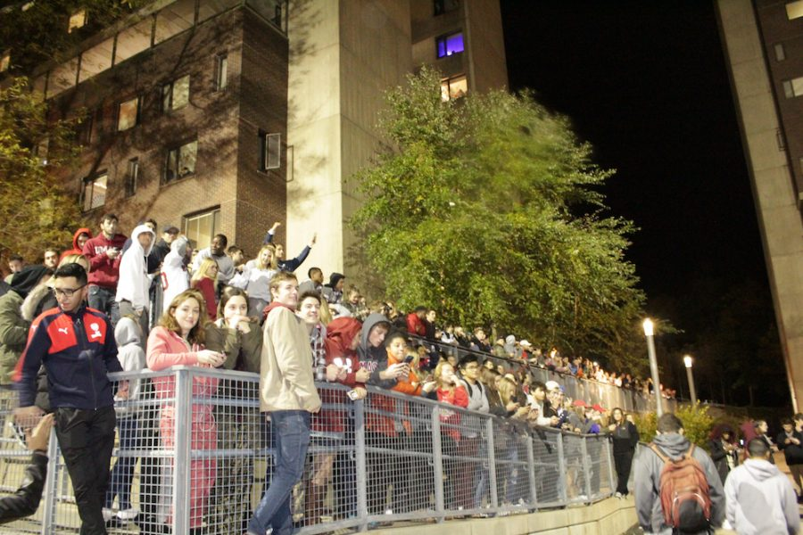 Onlookers watch the celebration from a distance on a ramp near John Adams Hall. (Brian Choquet/ Amherst Wire)