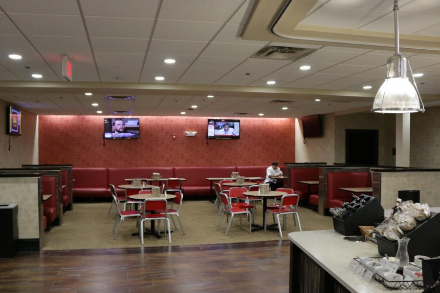 A UMass Dining chef takes a seat before Mount Idas on-campus  dining area opens. (Justin Risley/ Amherst Wire)