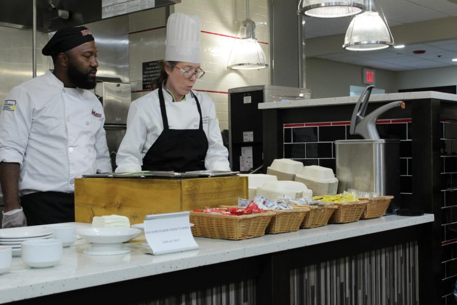 Two UMass Dining workers prepare for the opening of Mount Ida's dining area. (Brian Choquet/ Amherst Wire)