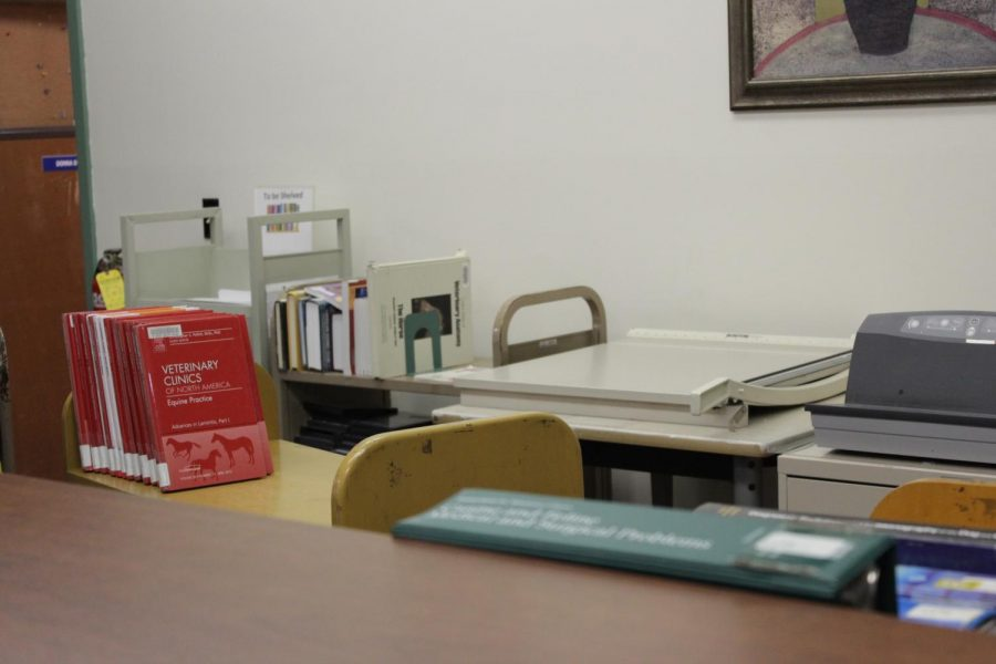 A cart of veterinary books sits behind the front desk at Wadsworth library. (Brian Choquet/ Amherst Wire)