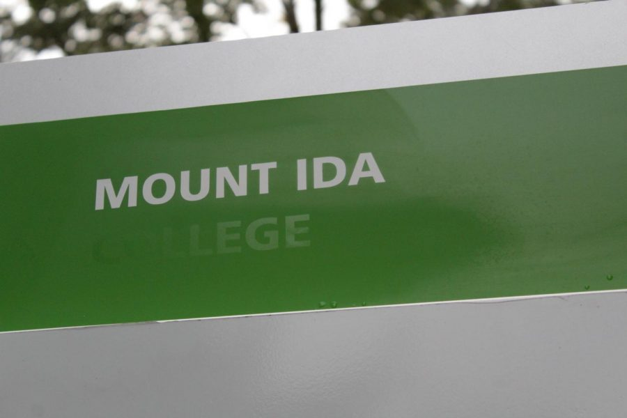 A directory sign near a campus entrance reads