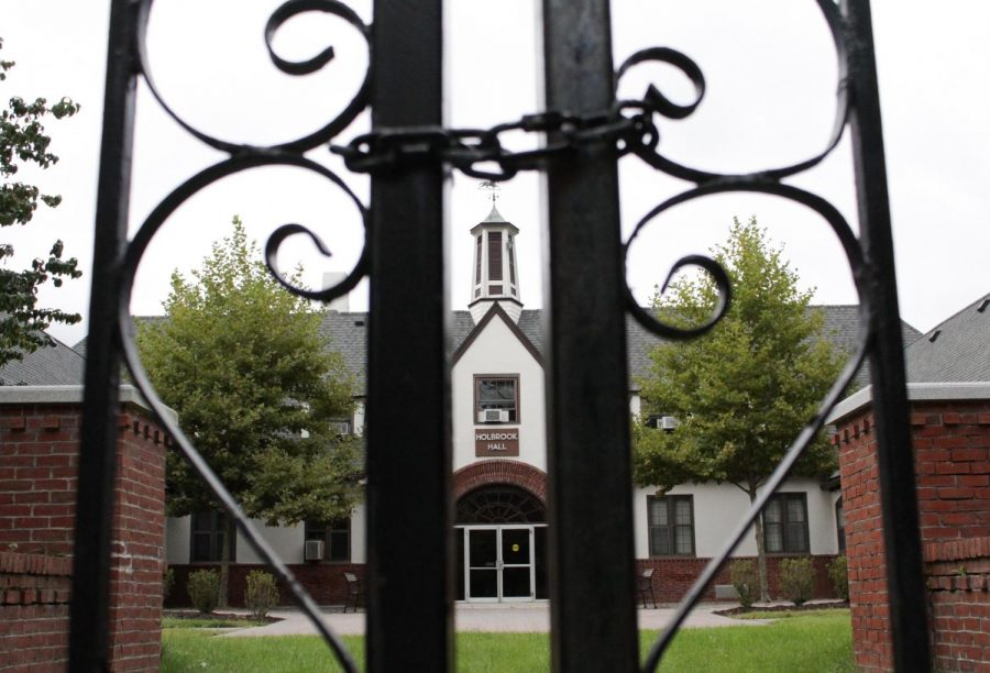 A chained-up gate blocks Holbrook Hall, which once held many of Mount Ida College's administrative offices. (Brian Choquet/ Amherst Wire)