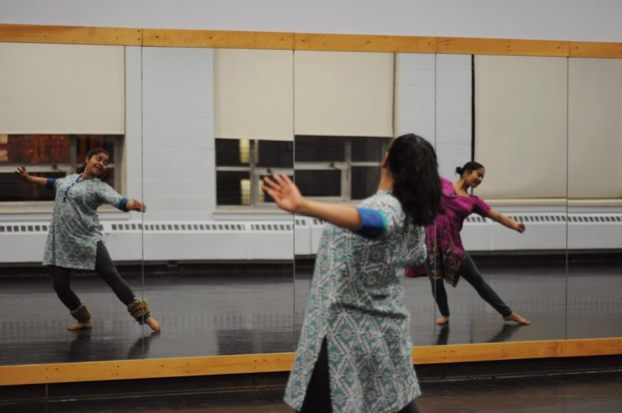 Ilina Shah in pink and Meg Banerjee in blue, in the midst of their choreography for their upcoming production in February.