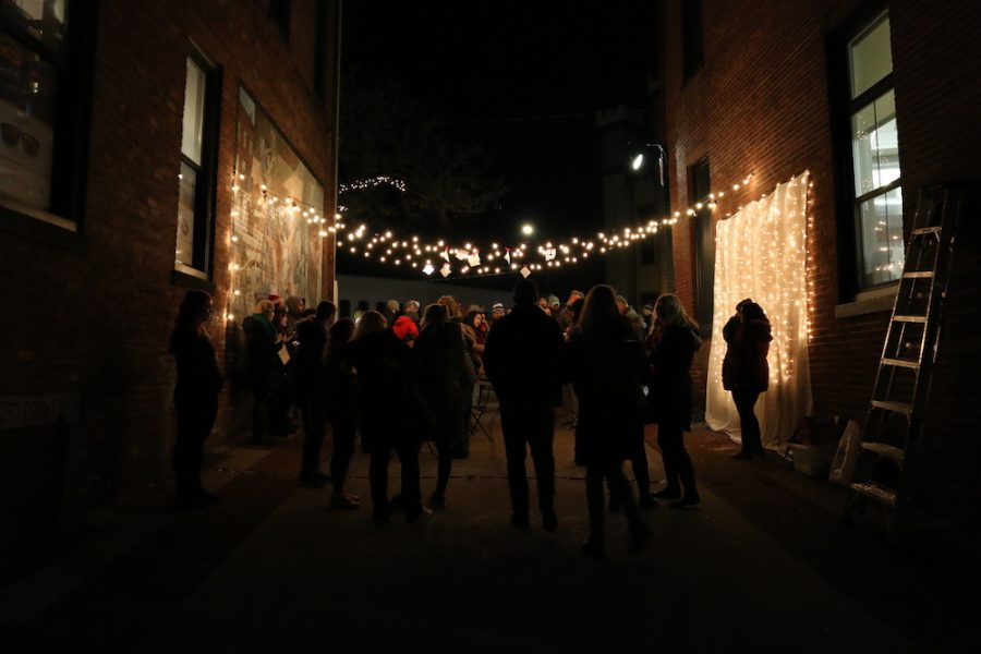 UMass students and the LARP department enjoy a newly decorated Cracker Barrel Alley on Main Street in Northampton, Mass. on Dec. 1, 2018. (Justin Risley/ Amherst Wire)