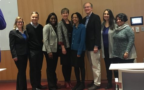 Dr. Gilda Barabino, center in the blue green jacket, posing with University of Massachusetts Amherst faculty and staff. (Julia Donohue/ Amherst Wire)