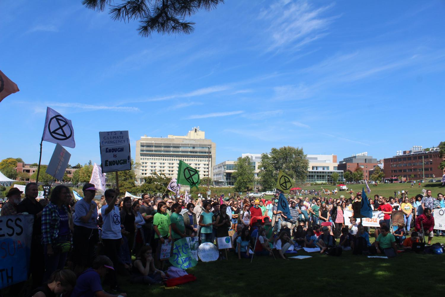 Students and community members gather on the East Campus Lawn for the Campus Climate Walk-Out held Friday, Sept.20.