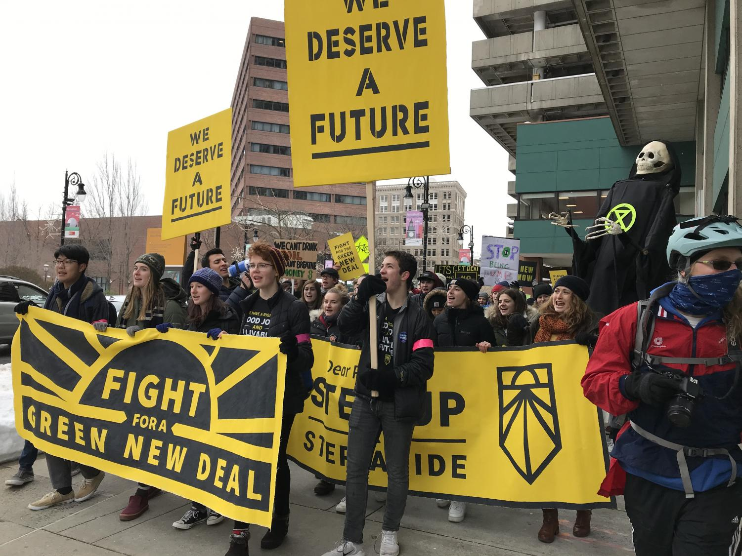 Students march in Springfield, MA to demand that Representative Richard Neal signs both the Green New Deal and the No Fossil Fuel Money Pledge