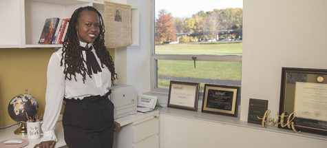 Jamila Lyiscott poses for Spotlight Scholar article