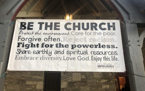 A sign outside First Church Amherst. (Harry Ortof/Amherst Wire)
