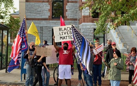 Black Lives Matter supporter in the middle of Trump supporters by Tristan Smith